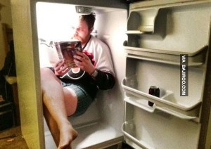 funny-guy-studying-book-in-fridge